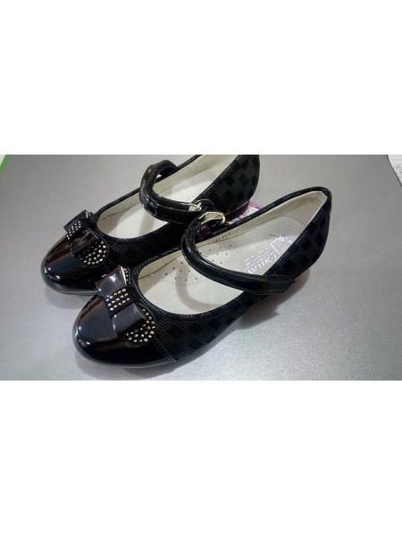 Школьные туфли для девочки черные лак